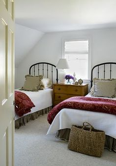 twin iron beds with red comforters.  loooove!  Kelly Mcguill