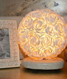 All shells are arranged delicately to form a round fixture that shimmers on polished stone base; Seashell Display, Coral Lamp, Shell Lamp, Shell Candles, Hamptons Decor, Shell Decorations, Driftwood Lamp, Light Crafts, Seashell Crafts