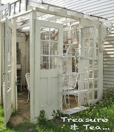 Outdoor Gazebo - built using salvaged windows and doors. This is perfect!