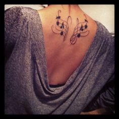 music wings tattoo