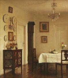Carl Holsöe Danmark 1863‑1935. Interiör med dukat bord. Signerad C Holsöe. Olja på pannå, 58 x 51.