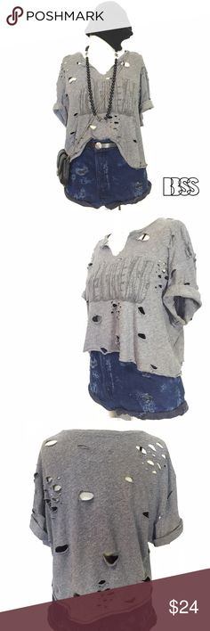 SUPER COZY DISTRESSED REWORKED GRAPHIC T-SHIRT! SUPER COZY DISTRESSED REWORKED GRAPHIC T-SHIRT! Amazing lightweight super comfy worn in heather fabric! TEE has been shortened with distressing all over garment! Vintage Tops Tees - Short Sleeve