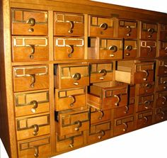 Card catalogs.  Rows and rows of drawers filled with cards about books.  Could it get any better?  Drawers.  Cards.  Books.