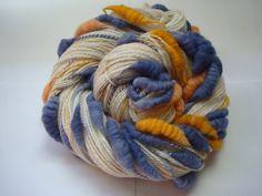 Handspun, hand dyed, core spun beehive yarn.