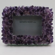 San Diego-based designer Kathryn McCoy sources the finest natural stones from around the world to create this eye - catching amethyst photo frame that glimmers from every angle. By: Kathryn McCoy Design Crystals In The Home, Diy Crystals, Stones And Crystals, Gem Stones, Black Crystals, Best Photo Frames, Cute Picture Frames, 3 Picture, Stuffed Animals