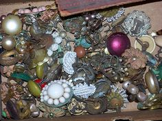 A hoarder's estate sale...a box of vintage junk jewelry