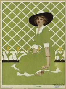 [Woman in green dress sitting beside tulips, 1910s.] (1912)