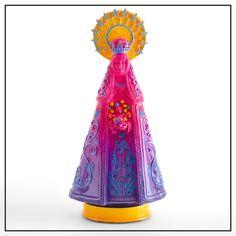 Virgen de Malasaña. Pieza de resina hecha en molde y pintada a mano. Medidas: 35x12x9 cm, Peso: 2 kg. Firmada y numerada, Disponible en nuestra tienda online.