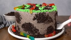 This Dirt Cake is a moist chocolate cake filled with frosting loaded with Oreos and layered with more Oreo crumbs! Its even got gummy worms between the cake layers for a cake thats creepy-crawly and perfect for Halloween! Dirt Cake Recipes, Dessert Recipes, Cheesecake Desserts, Raspberry Cheesecake, Strawberry Desserts, Food Cakes, Cupcake Cakes, Cupcakes, Worm Cake