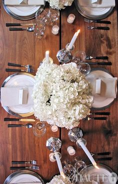 silver chargers and white plates with white hydrangeas- perfect for a white wedding  Charger Plates can make or break a decorated table!   I have a wide variety of charger plates, you can view more inspiration and my stock at www.facebook.com/labolaweddings