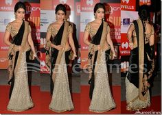Bollywood and South Indian actress Shriya in beautiful black and white half and half saree. Designed by Sabyasachi at SIIMA 2014. White embellished patch work designs all over white saree. Gold embellished  crystalized glittering work across it border. Paired with designer short sleeves saree blouse for back. Gold applique patch work designs all over blouse. Manish Malhotra Saree, Kareena Kapoor Saree, Sabyasachi Sarees, Bollywood Saree, Bollywood Actress, Indian Bridal Sarees, White Saree, Sari Blouse Designs, Saree Trends