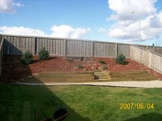 This steep slope is retained with an anchored wall using landscaping timbers.