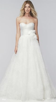 If you love mixing vintage finds with your designer pieces, this unique dress is the perfect fit for your style. All-over Malone lace gives this ivory wedding dress an incredible texture and vintage feel. The strapless sweetheart neckline and soft crinoline skirt with poly lining and chapel train bring lots of romance into the mix—bridal classics that will never go out of style. However, this gown isn't just about looking to the past. At the waist, a statement flower detail looks spritely…