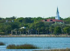 A church steeple behind the Henry Chambers Waterfront Park.........