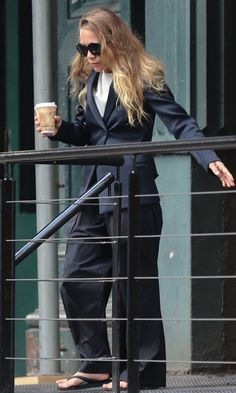 Mary-Kate Olsen // long wavy hair, navy blazer, wide-leg pants & flip flops #style #fashion #olsentwins