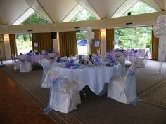 Using balloons for a white and purple wedding reception