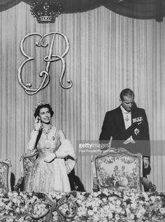 Queen Elizabeth II, wearing an evening gown and tiara, stands with Prince Philip, Duke of Edinburgh in the Royal box to watch the Scottish Royal Variety Show at the Alhambra Theatre in Glasgow, Scotland on July 3rd 1958.