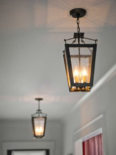 A duo of iron lanterns illuminates the foyer. Lighting fixtures throughout the house are on dimmers and can be scheduled to turn on and off upon entry-->  http://hg.tv/v80j