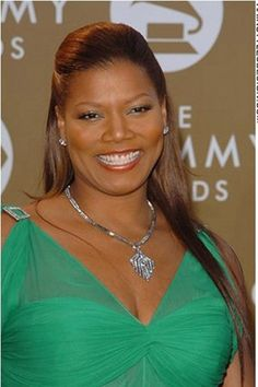 Queen Latifah looks incredible with her very long straight hair. This hairpiece has added length to her hair giving her this look. The front and sides of her hair has all been brushed back and clipped in the back.The hair is cut very long.Her hair colour is a dark golden brown.