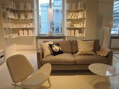 love the shelves full of white ceramics
