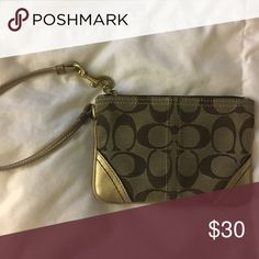 Coach wristlet Brown and gold wristlet with zipper closure. Everyone needs a little bag for a night in the town 💃🏻✨ Coach Bags Clutches & Wristlets