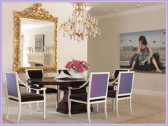 Love the mirror and purple chairs