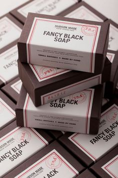 Beautiful soap packaging features black paper with label and red stamping.