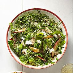 Grab a couple bags of arugula, spring mix or other greens for the base of this light nd refreshing pear salad.