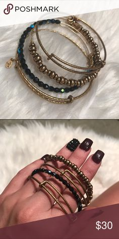 Alex & Ani Nile Beaded Bracelet Set Gold Set of four bangles including: 2 plain gold bangles, 1 gold beaded bangle, 1 hematite (bluish black beads) beaded bangle. Worn one time. Like new. Does not include tags or packaging. Alex & Ani Jewelry Bracelets