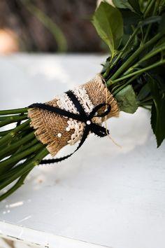 Burlap, lace, and black ribbon bouquet wrap.