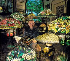 Tiffany love... Dr. Egon Neustadt sits among a small part of his vast collection of Tiffany glass. His treasures include a rare golden Lotus Leaf shade and lamp bases embellished with thick pieces of red and green turtleback glass. Photo by Mathew Brady