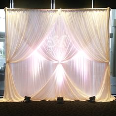 Multi layered chiffon wedding backdrop with 2 layer curtain ties & lighting for hire. Please advise width required & location for quote
