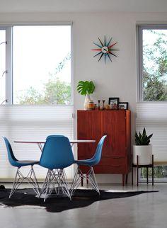 Modern. George Nelson clock + Eames eiffel base chairs
