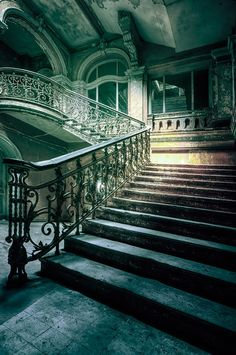 Beautiful stairway at an abandoned palace in Poland.