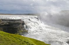 """Gullfoss is one of the most popular tourist attractions in the country. The wide Hvítá rushes southward. About a kilometre above the falls it turns sharply to the right and flows down into a wide curved three-step """"staircase"""" and then abruptly plunges in two stages (11 m and 21 m) into a crevice 32 m (105 ft) deep. The crevice, about 20 m (60 ft) wide, and 2.5 km in length... www.alkemia.is"""