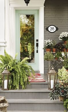 (there is THAT door again) gosh, I can't get it out of my design motif. Beautiful porch with painted gray brick