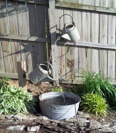 This cool-looking fountain made from recycled watering cans and a wash bin is the perfect addition to a country garden. Get the tutorial at Sophisticated Junkie.    - CountryLiving.com