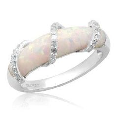 Opal ring, my birthstone. Excellent setting for an opal; they are 'soft' gemstones which causes them to fall out of pronged settings very easily.