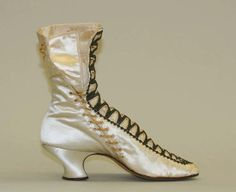 Boots Date: 1880 Culture: French Medium: silk Dimensions: Length: 9 in. (22.9 cm) Height: 8 in. (20.3 cm) Credit Line: Gift of Susan Dwight Bliss, 1937 Accession Number: 37.144.23