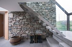 I like the idea of having one stone wall like this going all the way up through the centre of a house