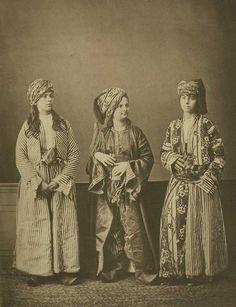 a kurd, an armenian, and a turkish woman pose for a photo. sivas, ottoman empire. 1870s.