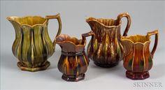 Four Bennington Pottery Flint Enamel Glazed Pitchers | Sale Number 2365, Lot Number 428 | Skinner Auctioneers
