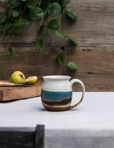 Ceramic Mug by Blue Eagle Pottery - Warm beverages have never been so appealing as when sipped from these handmade ceramic mugs. Artfully crafted by a husband and wife team, these tumblers are made of stoneware clay, and each piece is hand thrown on the wheel.