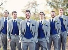 The navy bridesmaid dresses and grey groomsmen suits coordinate ...