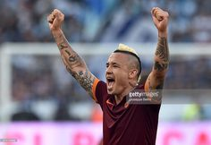 Radja Nainggolan of AS Roma celebrates the victory after the Serie A match between SS Lazio and AS Roma at Stadio Olimpico on May 25, 2015 in Rome, Italy.