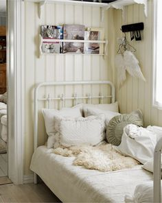 Whites and creams and a wrought iron bed. The wings are pretty perfect too.