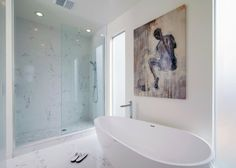 In this master bath plan, the freestanding tub sits by windows with privacy glass.