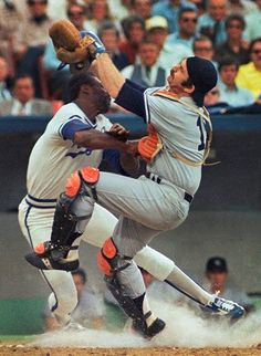 Thurman Munson, right, collides with a Kansas City Royals' runner at home plate.