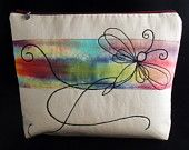 Cosmetic/toiletry bag with free machine embroidered design