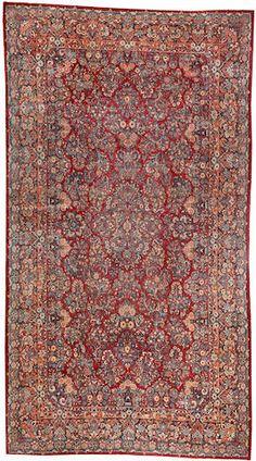 Sarouk carpet  Central Persia  circa 1930  size approximately 10ft. x 18ft.